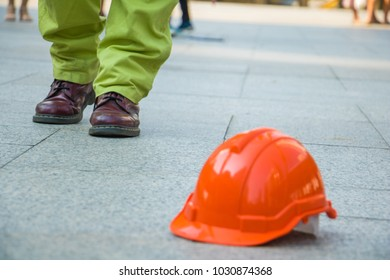 A man walking in to orange hat. Engineer man walking for work.He is move left foot and symbol for good work.photo concept work and succeed.