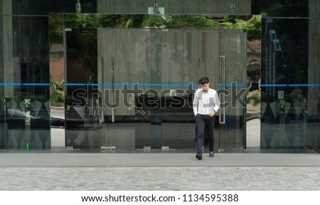 Man Walking Out From Building Office