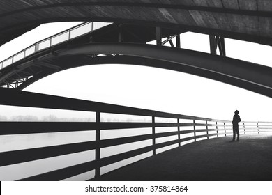 Man walking outdoor under bridge
