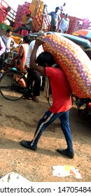 a man is walking with potato sack in the farmer market at district Katni Madhya Pradesh in India shot captured on Aug 5, 2019