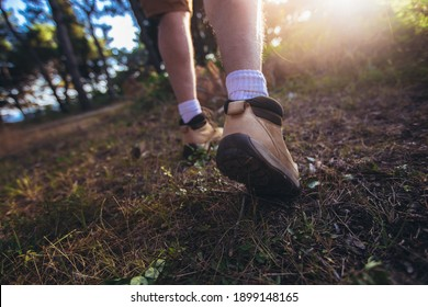 Man walking with sport shoes into nature view from the ground