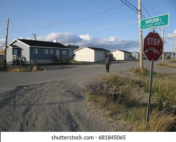 Man walking in a street of Kuujjuaq, Nunavik,Quebec, Canada