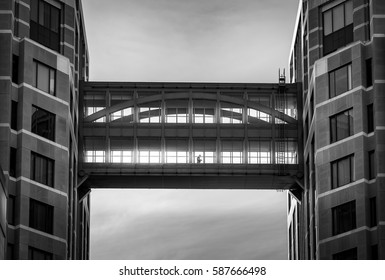 Man is walking through between modern building black and white, Abstract concept