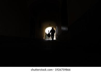 Man walking through tunnel in with his nandu bird