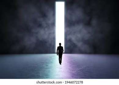 Man walking towards a light bar, dark space, future success concept