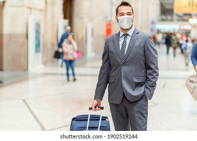 Man walking with a trolley at the station, coronavirus covid concept