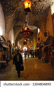 A man walks in Al-Madina Souq. It looks at souvenir shops, antiques and jewelery. Al-Madina Souq is the largest covered historical market in the world. Aleppo, Syria, Middle East. November 18, 2007.