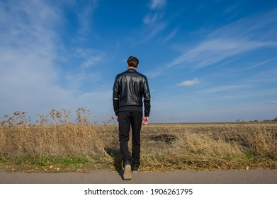 man walks in a field on a sunny day. Autumn season. Cover.
