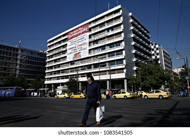 A man walks in front of Finance Ministry during a Symbolic occupation of the Finance Ministry from members of PAME in Athens, Greece on May 11, 2017