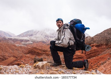 A man walks in the mountains and canyons