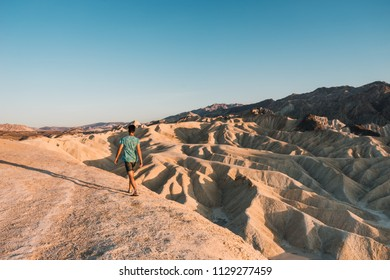 Man walks on the desert in the lowest point on earth in Death valley, USA, West Coast