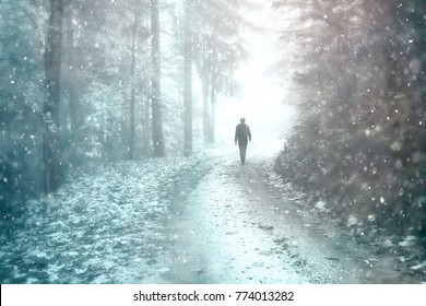 Man walks on forest road at snowy and foggy day. Glow and color filter effects effects used.