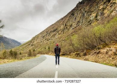 A Man walks on a Mountain Road in Switzerland