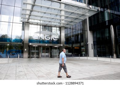 A man walks outside of French gas and power group Engie  company builidng in Brussels, Belgium on Jul. 7, 2018.