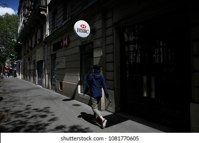 A man walks outside of HSBC Bank Branch in Paris, France on May 1, 2018.