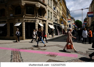 A man walks outside of  the Louis Vuitton store in commercial street of Luxembourg city on Jun. 22, 2018.