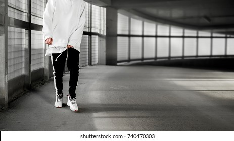 man walks in the parking. Urban photo. Life style wallpaper. Interior poster. Hype sneaker background