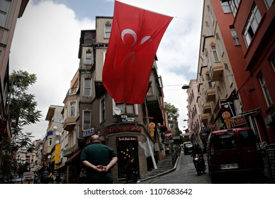 A man walks past of Flags of a Nationalist Movement Party (MHP) in the street of Istanbul, Turkey on June 2, 2015.