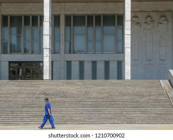 """A man walks past the National Opera and Ballet Theater of Moldova (Romanian: Teatrul Naţional de Operă şi Balet """"Maria Bieșu"""" din Republica Moldova) in Chişinău, Moldova, opened in 1957."""