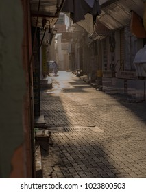 A man walks through the Manama Souq early on a summer day. Manama, Bahrain June 1, 2017.