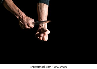 Man want to commit suicide by cutting his veins with knife.
