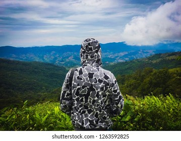 The man ware coat look out hill landscape in phuceefah chiangrai thailand
