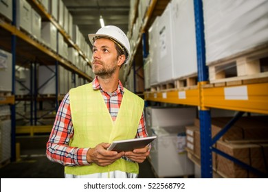 Man in a warehouse is checking inventory levels of goods. First in first out, Last in last out concept photo