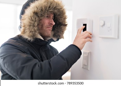 Man With Warm Clothing Feeling The Cold Inside House