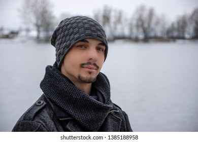 a man with warm clothing and hat on a cold winter day