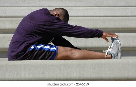 Man warms up and stretches before and after race