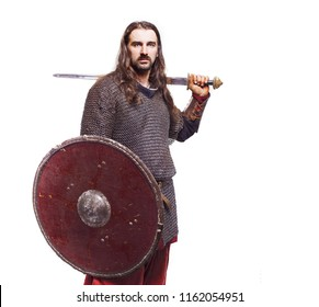 man warrior in medieval chain mail with sword, male portrait on a white background in chain armor, military soldier medieval knight, viking
