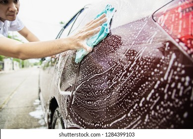 Man wash car using shampoo - every day life car care concept