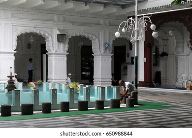 A man washes before praying at the Jummah Masjid (mosque) in Port Louis, Mauritius on Monday 28 May 2012