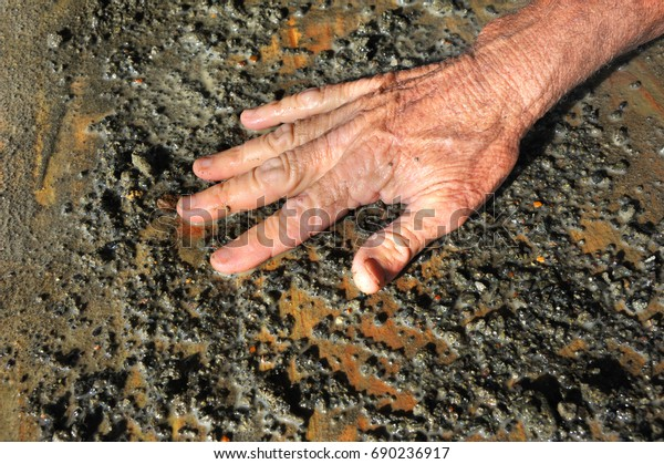 Man washes his gravel hunting for a diamond at the Crater of Diamonds State Park in Arkansas.  Closeup of Hand.
