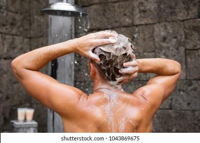 Man washing head with shampoo