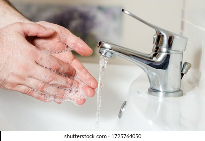 Man washing her hands after returning from shopping or  work .Prevention and protection against bacteria and covid-19, hepatitis a .