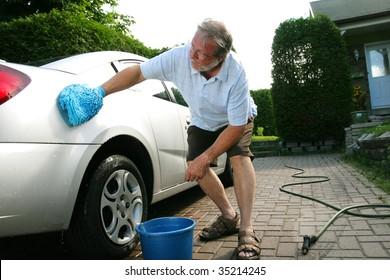 Man washing the silver car
