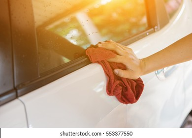 man washing a soapy black car with a cloth,detailing series : Worker cleaning white mini van,vintage color