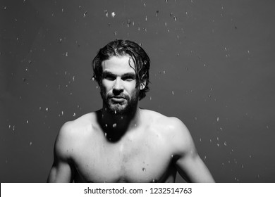man washing with water drops in morning. naked guy with long hair refreshing in shower or bath on green background, hygiene and skincare, health and wakeup, everyday life, barbershop