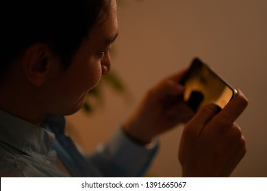 Man watching content on a smartphone