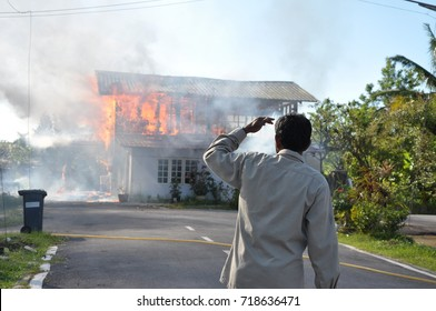 A Man Watching The House On Fire In Kuching, Sarawak, Malaysia