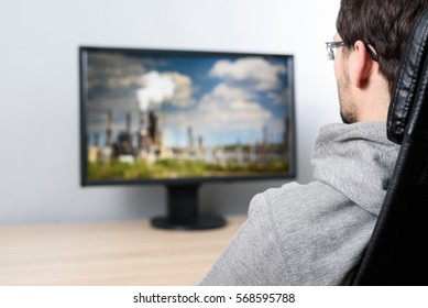 man watching (on TV) massive air pollution produced by factories