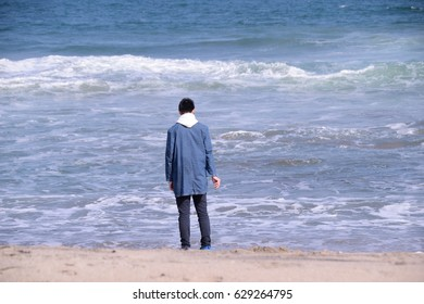 A man watching the sea. Background,coast,blue,wave.