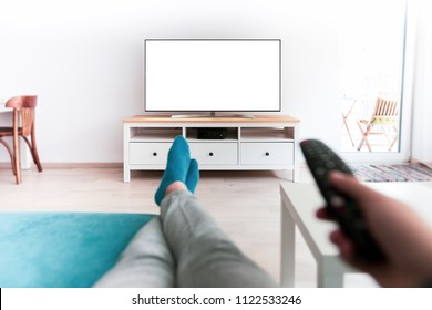 Man watching smart tv blank screen controlled by smart remote - point of view perspective