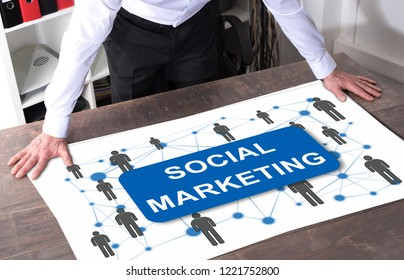 Man watching a social marketing concept placed on a desk