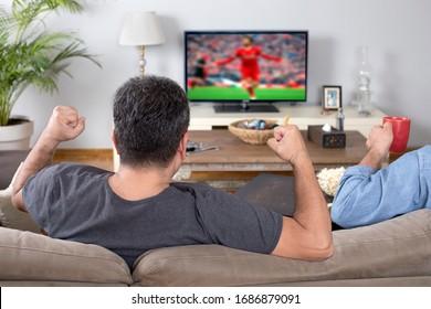 man watching sport on tv