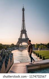 Man watching Sunrise by eifel tower, man looking at eifel tower city trip in Paris