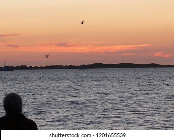 Man watching Sunset at Rockingham Beach Western Australia