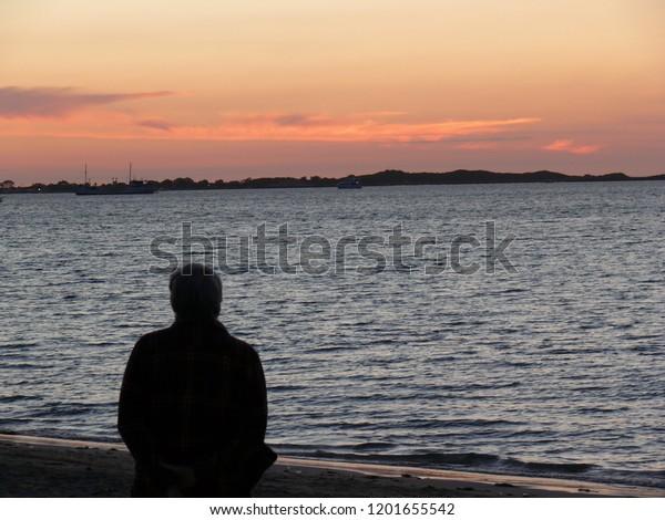 Man watching Sunset at Rockingham Beach Western Australia