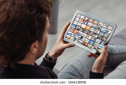 Man watching TV on tablet. Television, multimedia streaming services